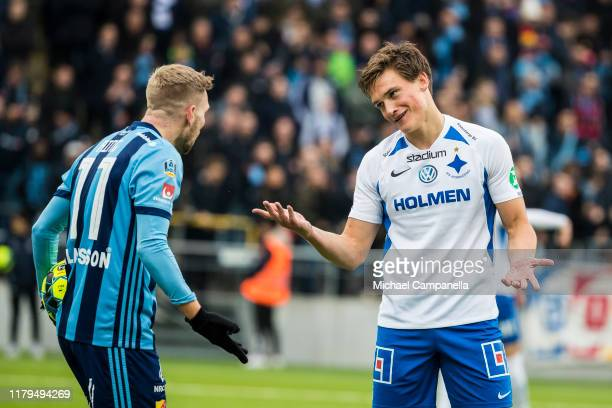 Rasmus Stensbaek Lauritsen of IFK Norrkoping argues with Jonathan Ring of Djurgardens IF during an Allsvenskan match between IFK Norrkoping and...