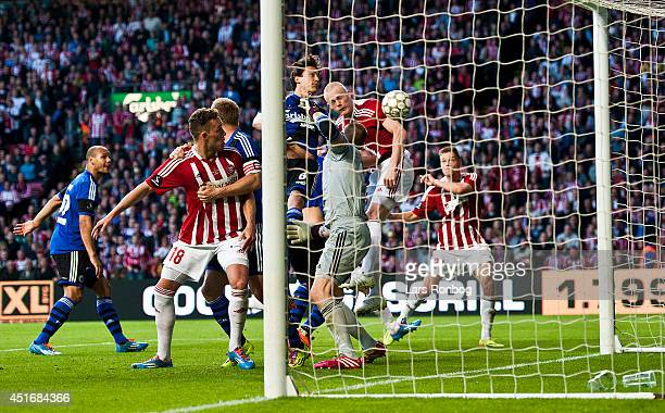 Rasmus Thelander of AaB Aalborg scores the 11 goal on a header against Goalkeeper Johan Wiland of FC Copenhagen during the DBU Pokalen Cup Final...