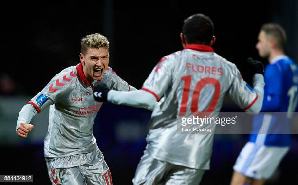 Rasmus Thellufsen and Edison Flores of AaB Aalborg celebrate after scoring their second goal during the Danish Alka Superliga match between Lyngby BK...
