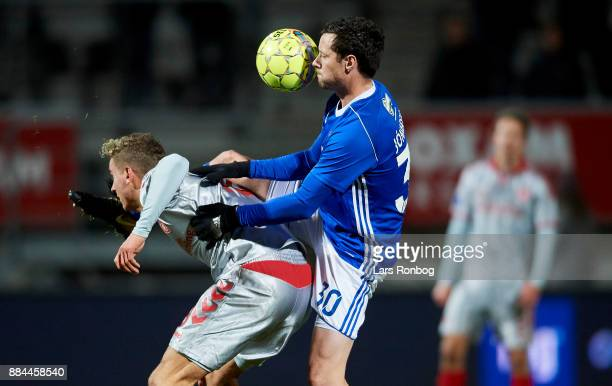 Rasmus Thellufsen of AaB Aalborg and Hallgrimur Jonasson of Lyngby BK compete for the ball during the Danish Alka Superliga match between Lyngby BK...