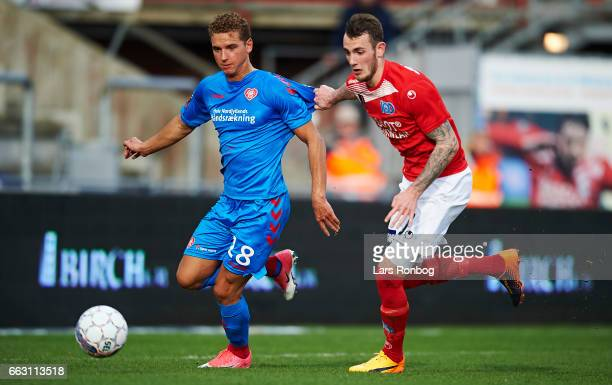 Rasmus Thellufsen of AaB Aalborg and Jens Martin Gammelby of Silkeborg IF compete for the ball during the Danish Alka Superliga match between...