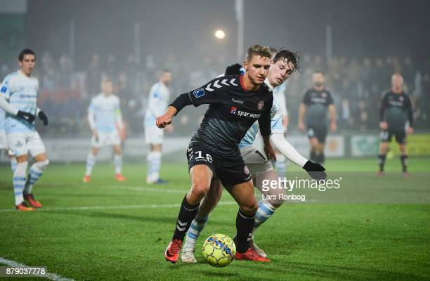 Rasmus Thellufsen of AaB Aalborg and Nicolas Mortensen of FC Helsingor compete for the ball during the Danish Alka Superliga match between FC...