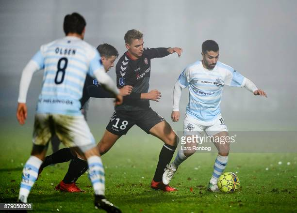 Rasmus Thellufsen of AaB Aalborg and Osama Akharraz of FC Helsingor compete for the ball during the Danish Alka Superliga match between FC Helsingor...