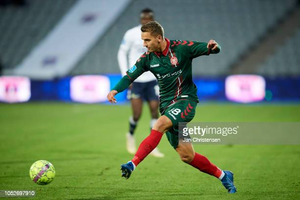 Rasmus Thellufsen of AaB Aalborg controls the ball during the Danish Superliga match between AGF Arhus and AaB Aalborg at Ceres Park on October 21...
