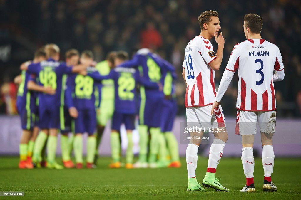 Rasmus Thellufsen speaks to Jakob Ahlmann of AaB Aalborg during halftime in the Danish Alka Superliga match between AaB Aalborg and FC Midtjylland at Aalborg Portland Park on March 13, 2017 in Aalborg, Denmark.