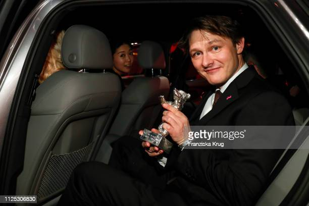 Rasmus Videbaek sits in Audi etron car after the closing ceremony of the 69th Berlinale International Film Festival Berlin at Berlinale Palace on...