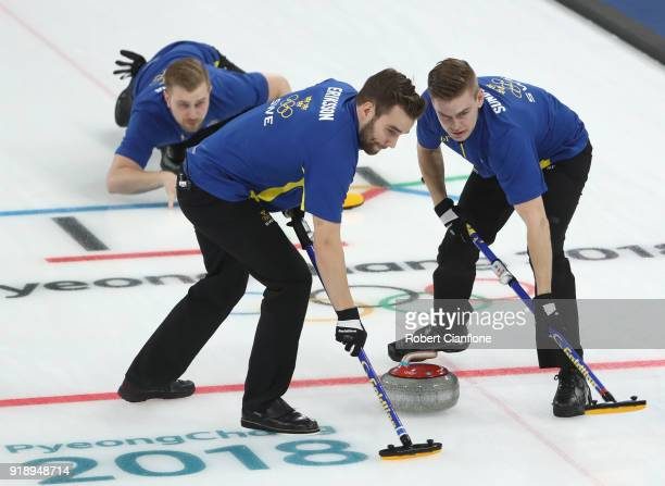 Rasmus Wranaa Oskar Eriksson and Christoffer Sundgren of Sweden compete in the Curling Men's Round Robin Session 5 held at Gangneung Curling Centre...