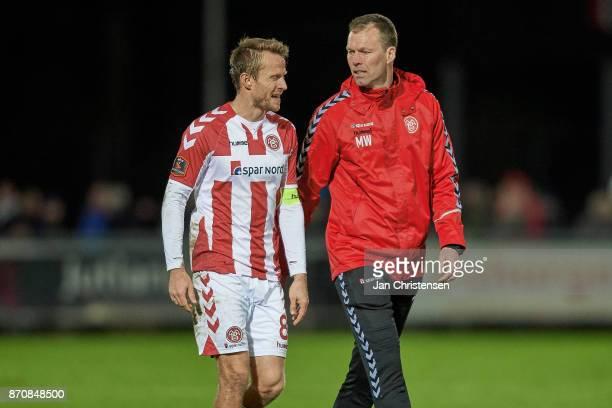Rasmus Würtz of AaB Aalborg and Morten Wieghorst head coach of AaB Aalborg after the Danish Alka Superliga match between Hobro IK and AaB Aalborg at...