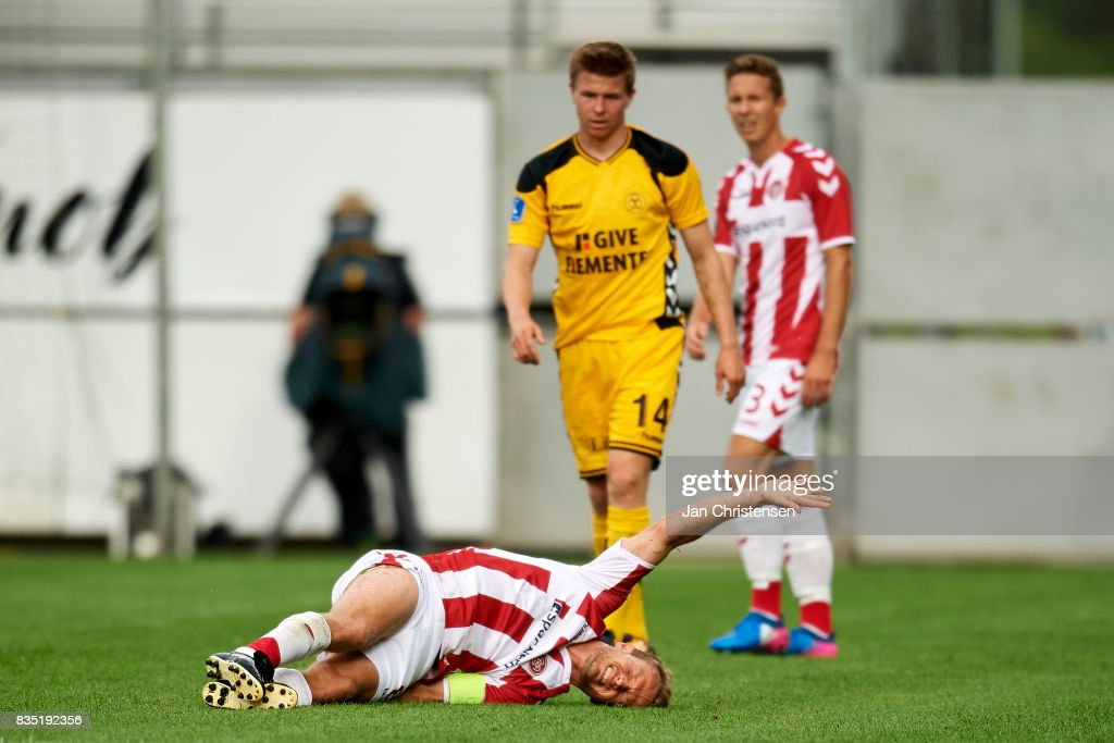 Rasmus Würtz of AaB Aalborg get an injury during the Danish Alka Superliga match between AC Horsens and AaB Aalborg at Casa Arena Horsens on August 18, 2017 in Horsens, Denmark.