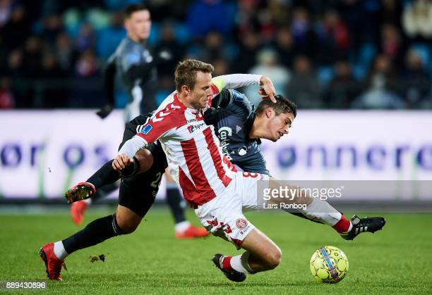 Rasmus Wurtz of AaB Aalborg and Pieros Sotiriou of FC Copenhagen compete for the ball during the Danish Alka Superliga match between AaB Aalborg and...