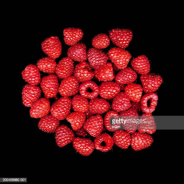 Raspberries against black background, close-up