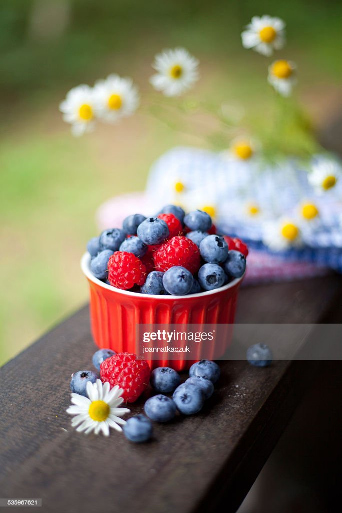 Raspberries and blueberries fruits. : Stock Photo