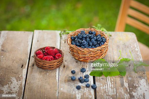 Raspberries and blueberries in baskets
