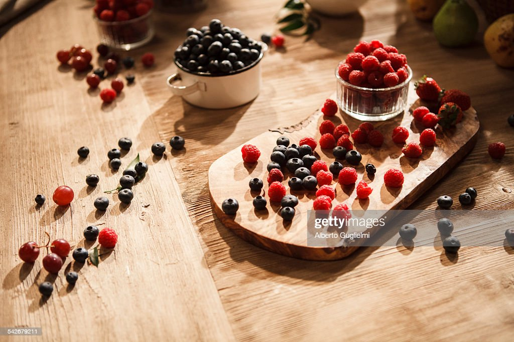 Raspberries and blueberries : Stock Photo
