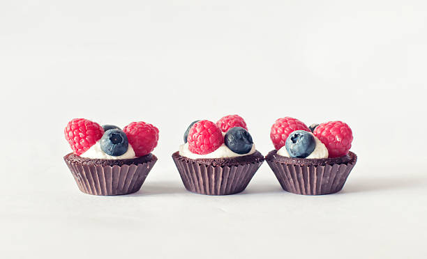 Raspberries and blueberries trio of mini cupcake