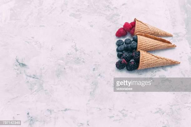 Raspberries, blackberries and blueberries in waffle cones