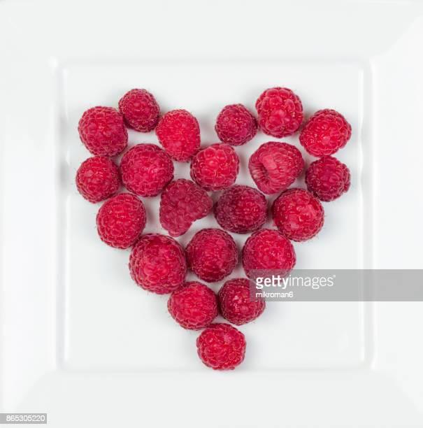 Raspberries fruit in heart shape