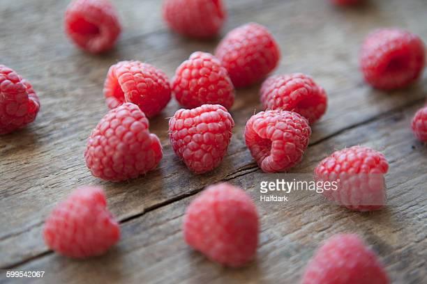 Raspberries on wooden table