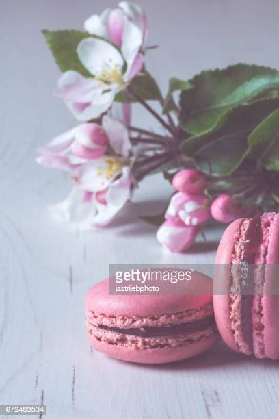 raspberry macaroons on white wooden table - macarons stock photos and pictures
