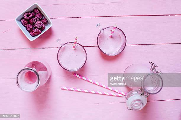 Raspberry smoothie on pink ground