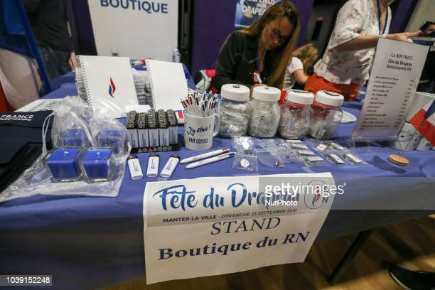 Rassemblement national promotional products displayed at a stall during RN party's fair Fete du drapeau on September 23 2018 in ManteslaVille outside...
