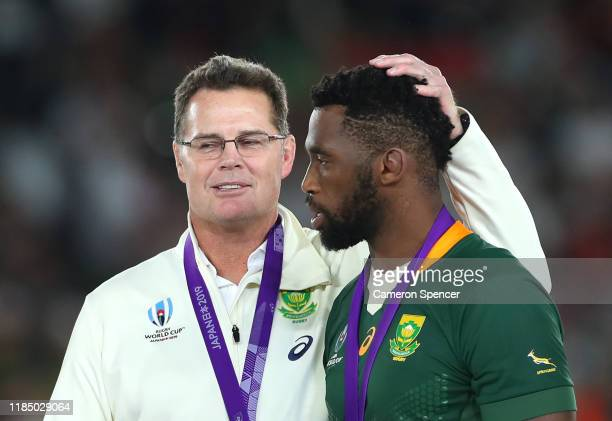 Rassie Erasmus, Head Coach of South Africa talks to Siya Kolisi of South Africa after victory in the Rugby World Cup 2019 Final between England and...