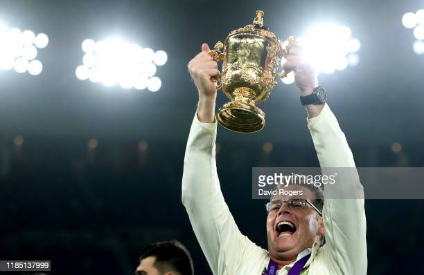Rassie Erasmus the South Africa head coach holds aloft the Webb Ellis Cup after their victory during the Rugby World Cup 2019 Final between England...