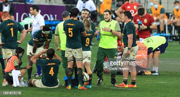 Rassie Erasmus, the Springboks director of rugby acting as a water carrier talks to his team during the 2nd test match between South Africa...