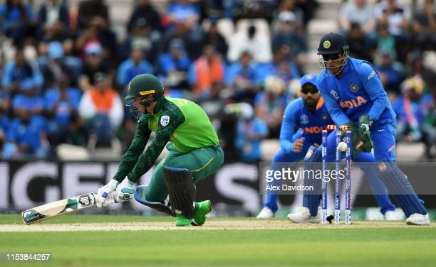 Rassie van der Dussen of South Africa attempts to reverse sweep but is bowled by Yuzvendra Chahal of India watched on by MS Dhoni of India during the...