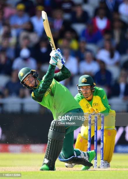 Rassie van der Dussen of South Africa in action batting as Alex Carey of Australia looks on during the Group Stage match of the ICC Cricket World Cup...