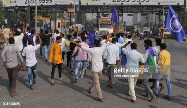 Rasta Roko by Dalit protesters during Maharashtra Bandh at Dahisar Checknaka they demand arrested of Sambhaji Bhide and Milind Ekbote on January 4...