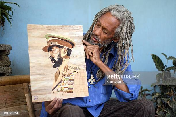 Rastafarian and banana artist Bandi Payne who moved to Shashamane in 1994 poses for a photograph with one of his works on January 26 2017 in...