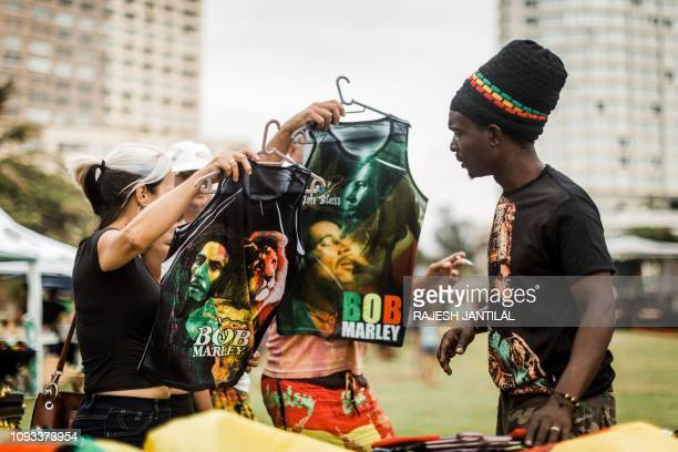 Rastafarian Reggae fans look at clothes at the start of the Bob Marley One Love Festival and Rasta Fair to commemorate and celebrate the life of Bob...