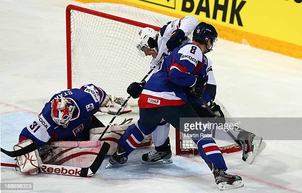 Rastislav Stana , goaltender of Slovakia makes a save on TJ Oshie of USA during the IIHF World Championship group H match between Slovakia and USA at...