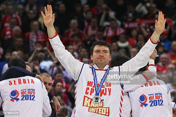 Rastko Stojkovic of Serbia celebrates winning the silver medal on the podium after losing 1921 the Men's European Handball Championship final match...