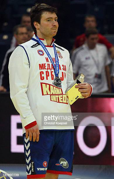 Rastko Stojkovic of Serbia looks dejected on the podium after losing 19-21 the Men's European Handball Championship final match between Serbia and...