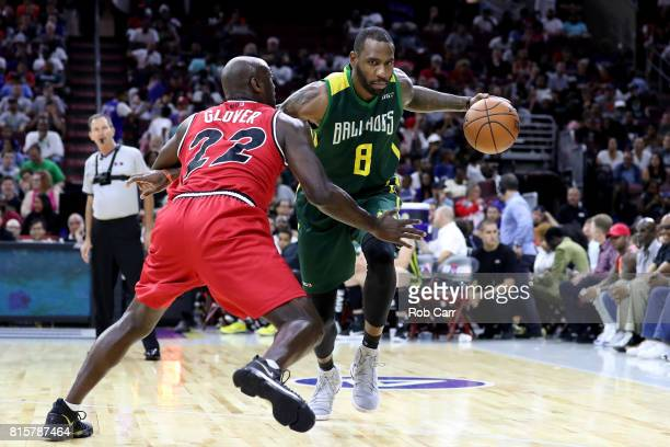 Rasual Butler of the Ball Hogs handles the ball against Dion Glover of Trilogy during week four of the BIG3 three on three basketball league at Wells...