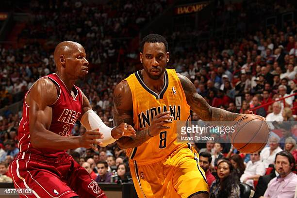 Rasual Butler of the Indiana Pacers drives to the basket against the Miami Heat on December 18 2013 at American Airlines Arena in Miami Florida NOTE...