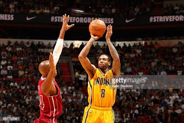 Rasual Butler of the Indiana Pacers shoots against the Miami Heat on December 18 2013 at American Airlines Arena in Miami Florida NOTE TO USER User...