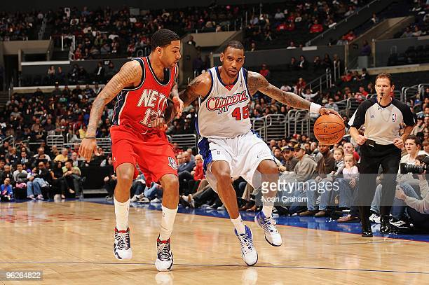 Rasual Butler of the Los Angeles Clippers moves the ball against Chris DouglasRoberts of the New Jersey Nets during the game at Staples Center on...