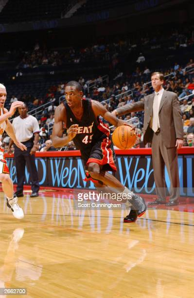Rasual Butler of the Miami Heat dribble drives to the basket during the NBA preseason game against the Atlanta Hawks at Philips Arena on October 16...