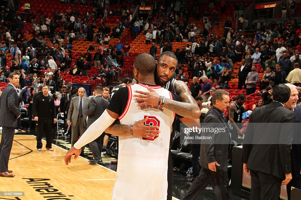 Rasual Butler #18 of the San Antonio Spurs and Dwyane Wade #3 of the Miami Heat hug after the game on February 9, 2016 at American Airlines Arena in Miami, Florida.