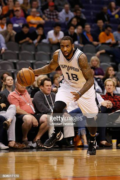 Rasual Butler of the San Antonio Spurs handles the ball during the NBA game against the Phoenix Suns at Talking Stick Resort Arena on January 21 2016...