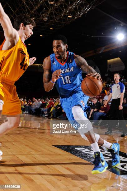 Rasual Butler of the Tulsa 66ers drives against Ryan Rossiter of the Canton Charge during an NBA DLeague playoff game at the Canton Memorial Civic...