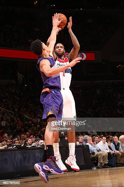 Rasual Butler of the Washington Wizard shoots the ball against the Phoenix Suns on December 21 2014 at Verizon Center in Washington District of...