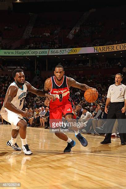 Rasual Butler of the Washington Wizards dribbles against the Charlotte Hornets at Bon Secours Wellness Arena on October 10 2014 in Greenville South...