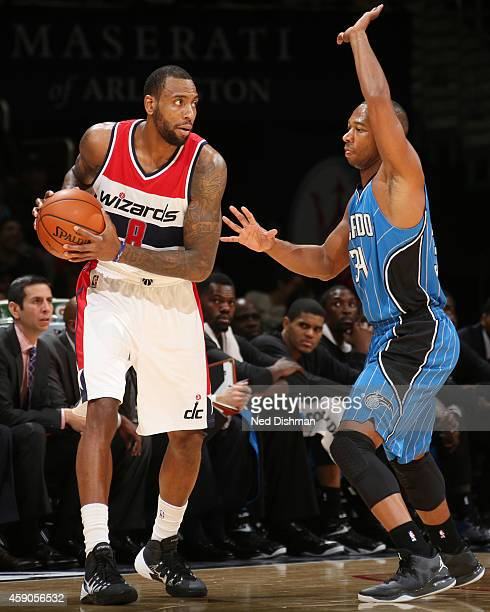Rasual Butler of the Washington Wizards looks to pass the ball against Willie Green of the Orlando Magicduring the game on November 15 2014 at...
