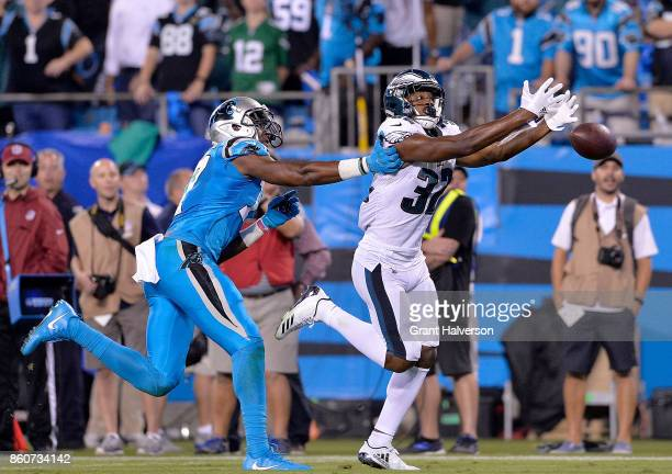 Rasul Douglas of the Philadelphia Eagles just misses an onterception on a pass intended for Devin Funchess of the Carolina Panthers during their game...