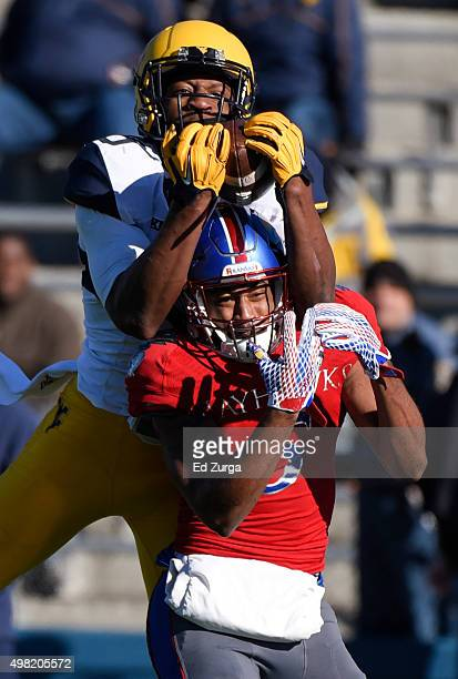 Rasul Douglas of the West Virginia Mountaineers intercepts a pass intended for Bobby Hartzog Jr. #5 of the Kansas Jayhawks in the third quarter at...