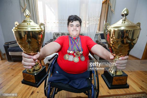 Rasul Zakiyev Paralympic dancer shows his medals in his house during the governmentordered lockdown to stop spread of COVID19 on July 10 2020 in Baku...